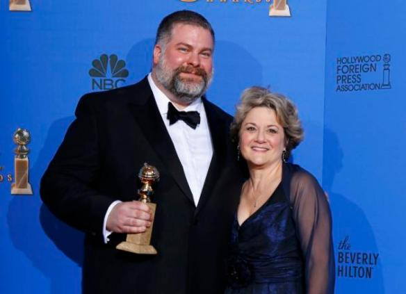 "Director DuBois and producer Arnold pose backstage after they won the award for Best Animated Feature Film for ""How to Train Your Dragon 2"" at the 72nd Golden Globe Awards in Beverly Hills"